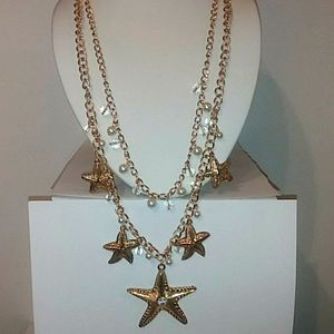 Starfish Gold tone necklace. 2 strands beaded. Nwt
